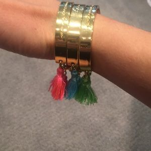 Lilly Pulitzer gold bracelets with tassels
